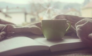 Reading and drinking coffee